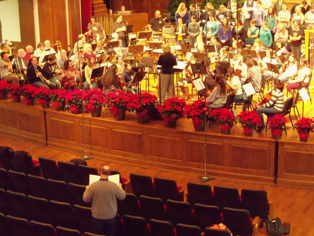 Composer Jesse Ayers at rehearsal for premiere Milligan College Orchestra-Chorus Christmas Commission